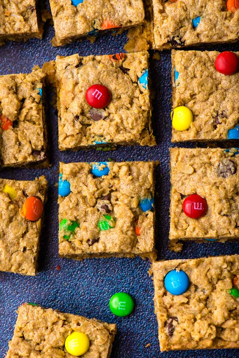 Monster Cookie Bars with M&Ms on a dark background