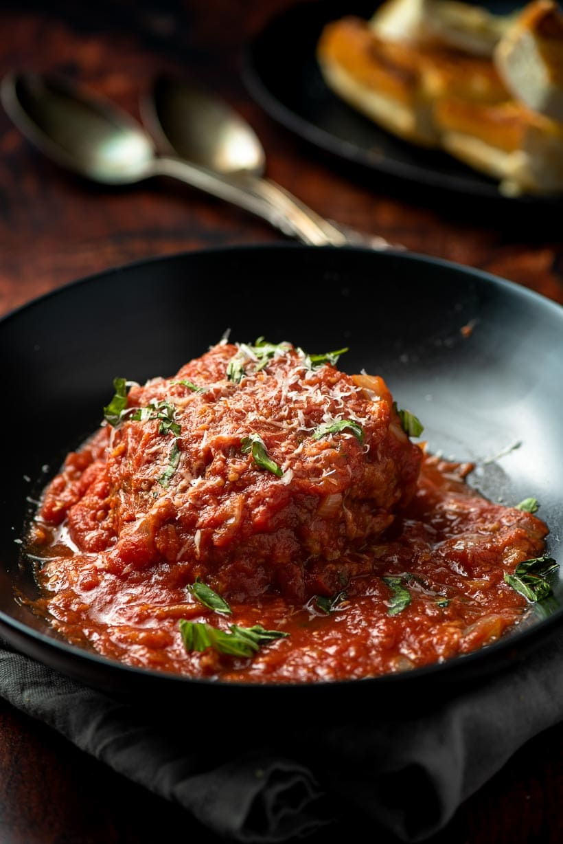 giant meatball with parmesan and basil on top
