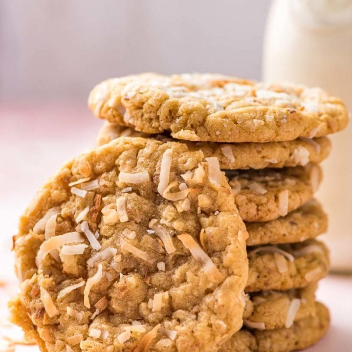 stack of coconut cookies with one cookie propped in front