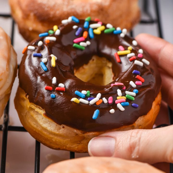 chocolate glazed air fryer donuts with sprinkles on top