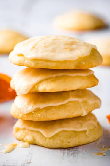 iced orange cookies in a stack of four