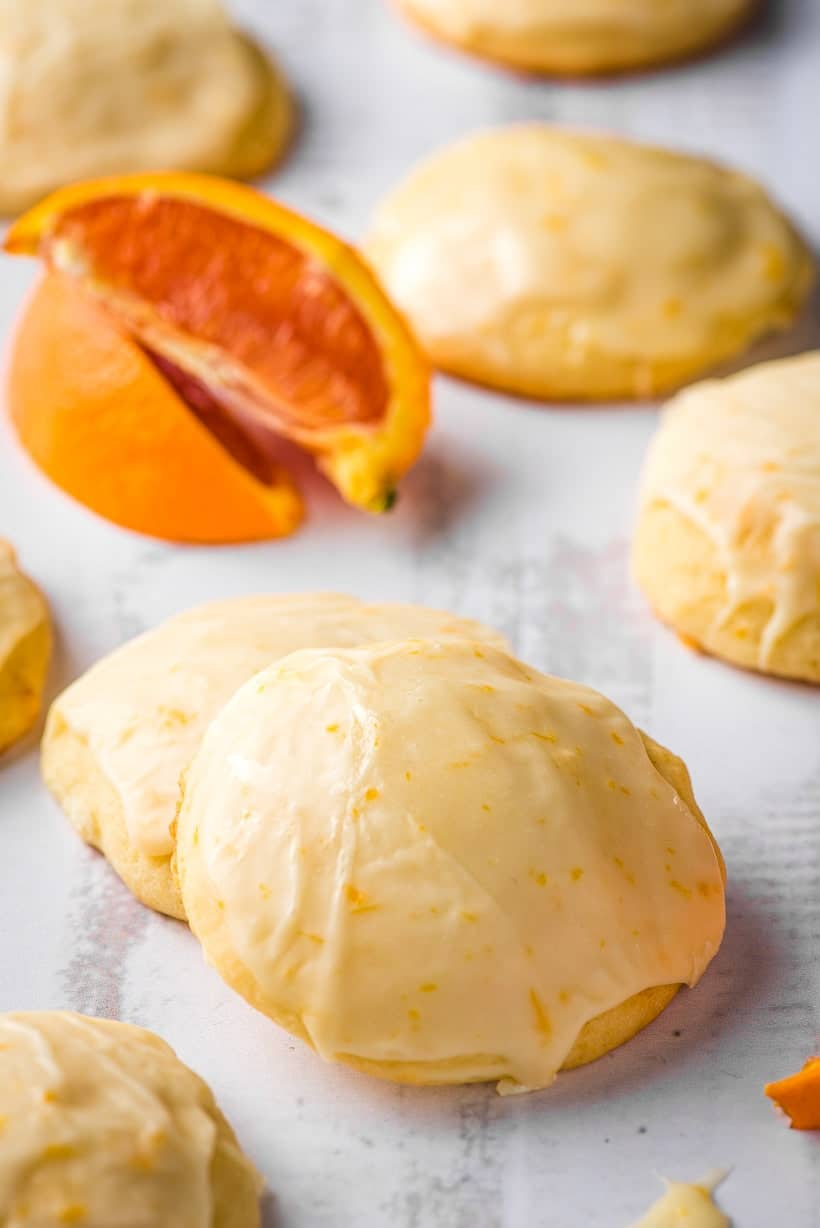 orange cookies and orange slices on a gray background