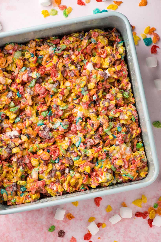 blue square baking pan holding Fruity Pebble Krispie Treats