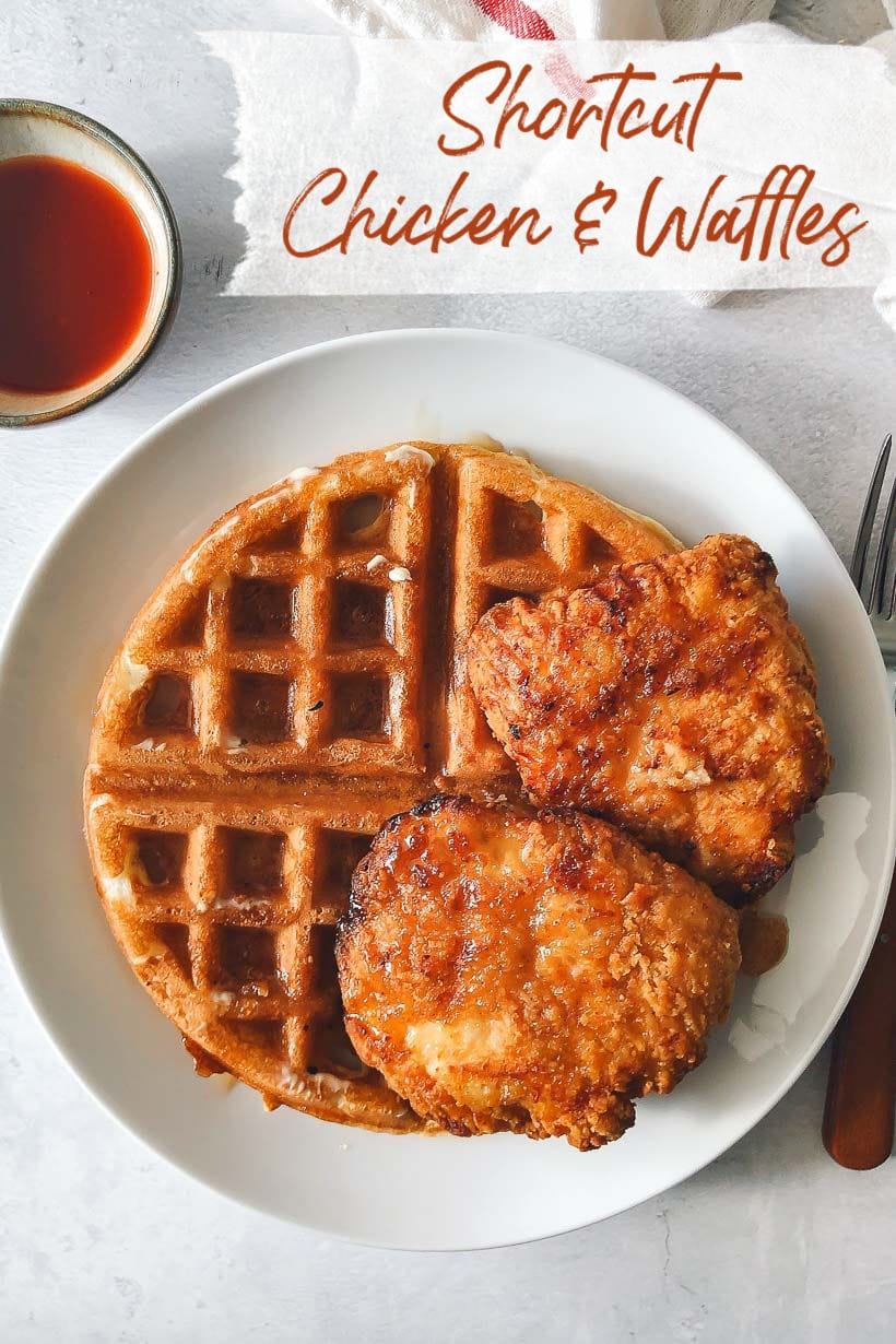 Quick Chicken and Waffles with syrup and a bowl of hot sauce