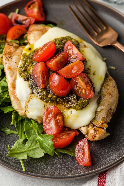 grilled chicken breast with mozzarella, tomato, and pesto