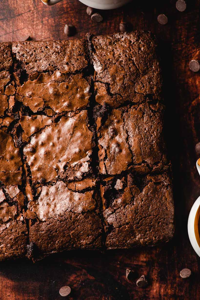 easy homemade brownies surrounded by chocolate chips