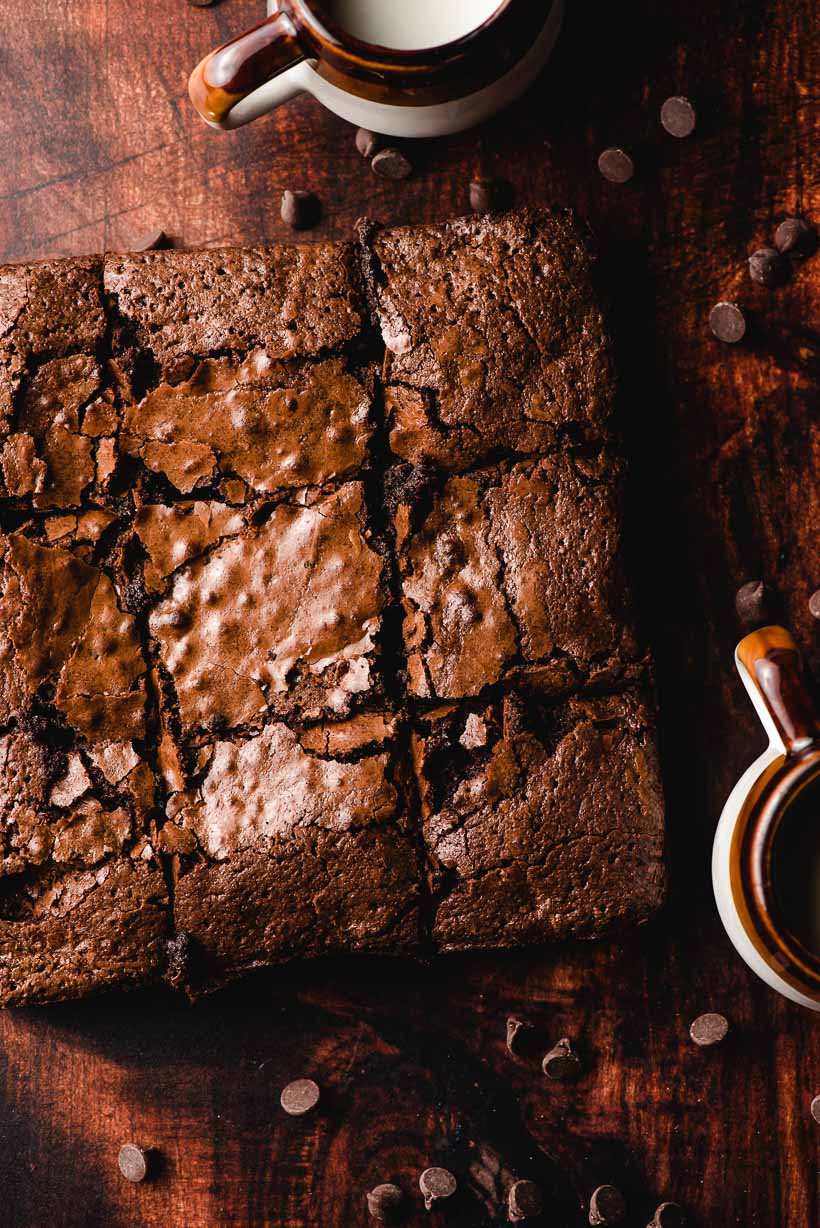 easy homemade brownies with mugs of milk