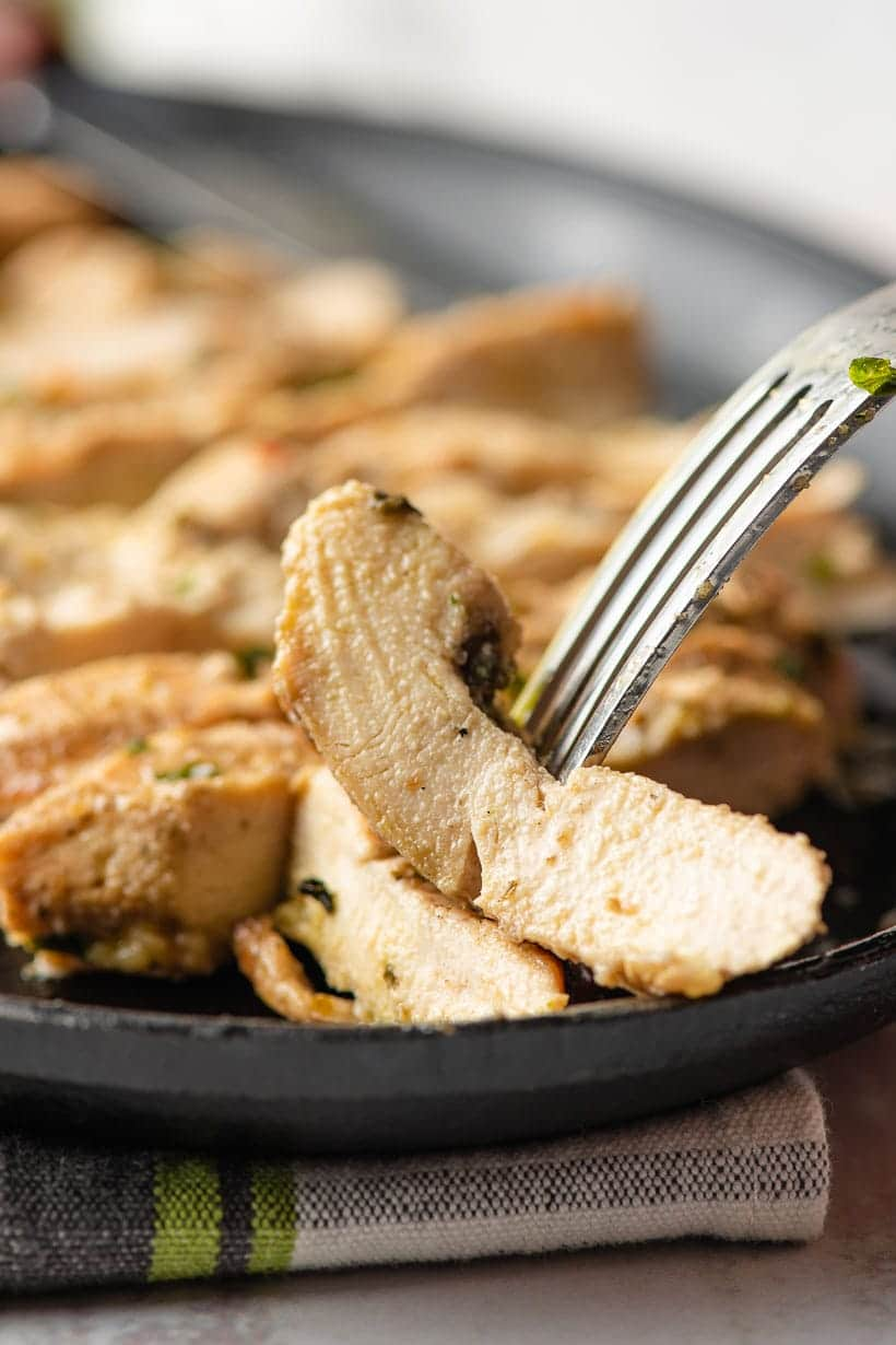 Fork spearing a slice of Italian Dressing Chicken