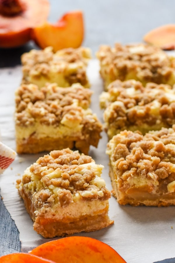 slice of peach cheesecake crumb bars