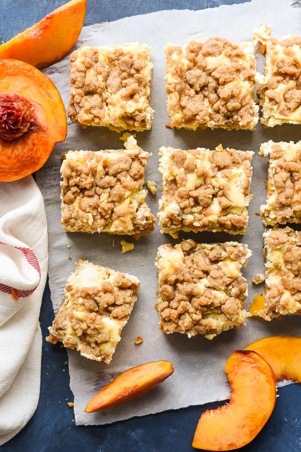 peach crumble bars cut in slices with peach halves