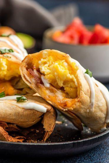 Scrambled eggs and bacon inside an air fryer breakfast burrito