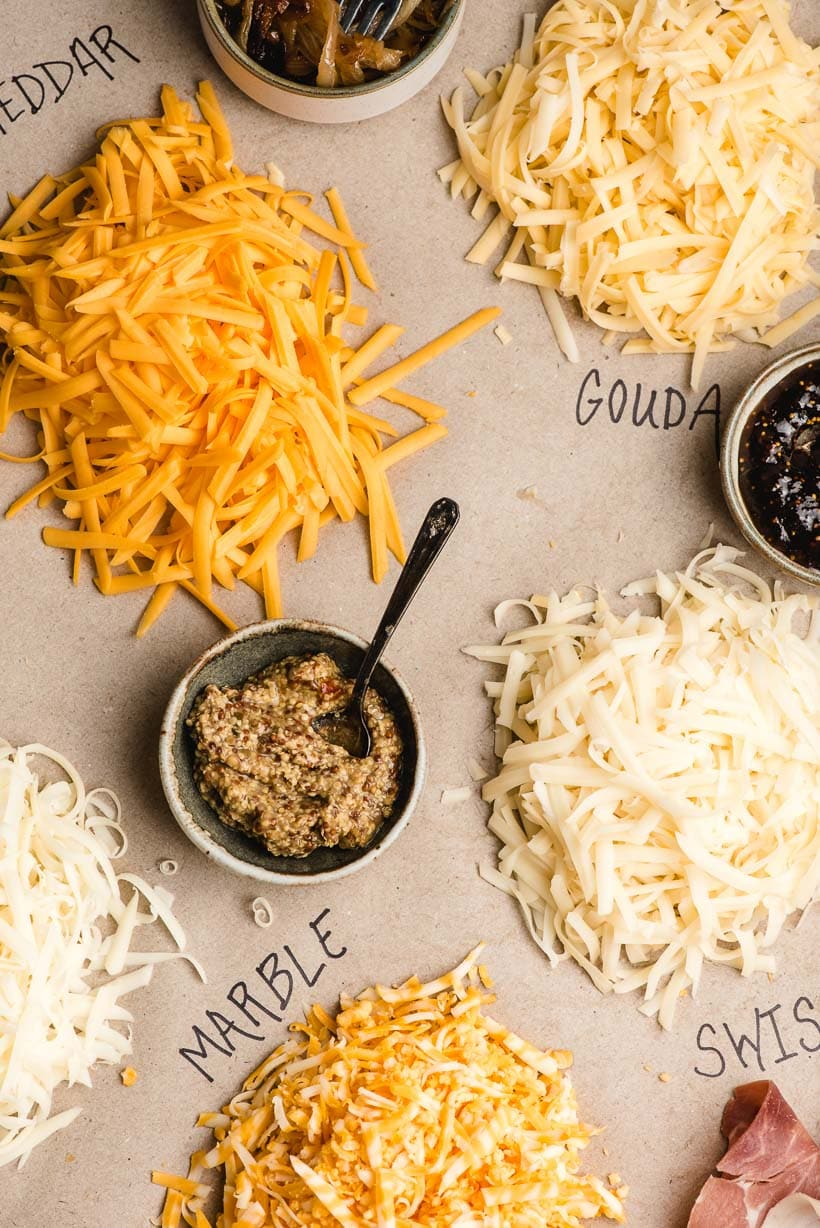 shredded cheese and sandwich toppings on paper background