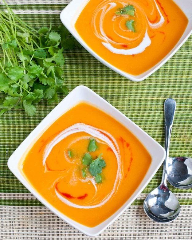 sweet potato soup with coconut milk and Sriracha swirled on top