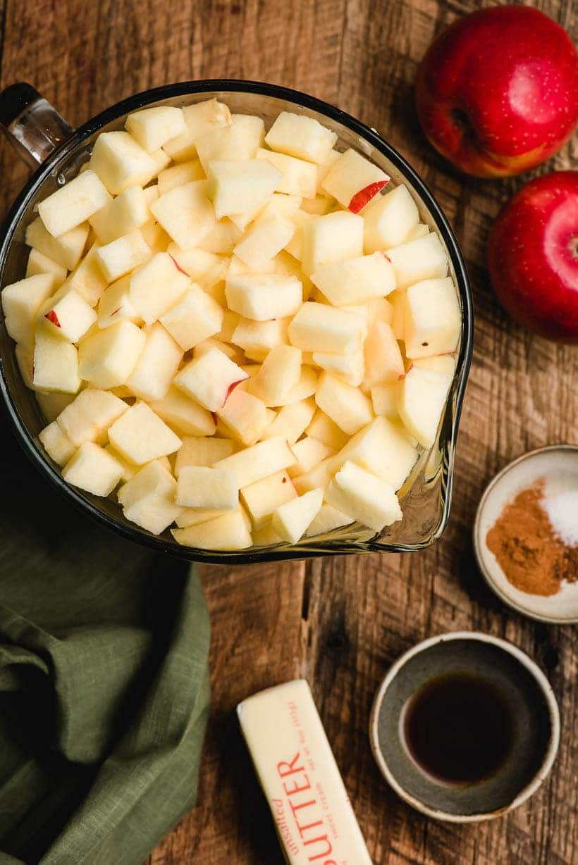 bowl of chopped apples with other apple pie ingredients