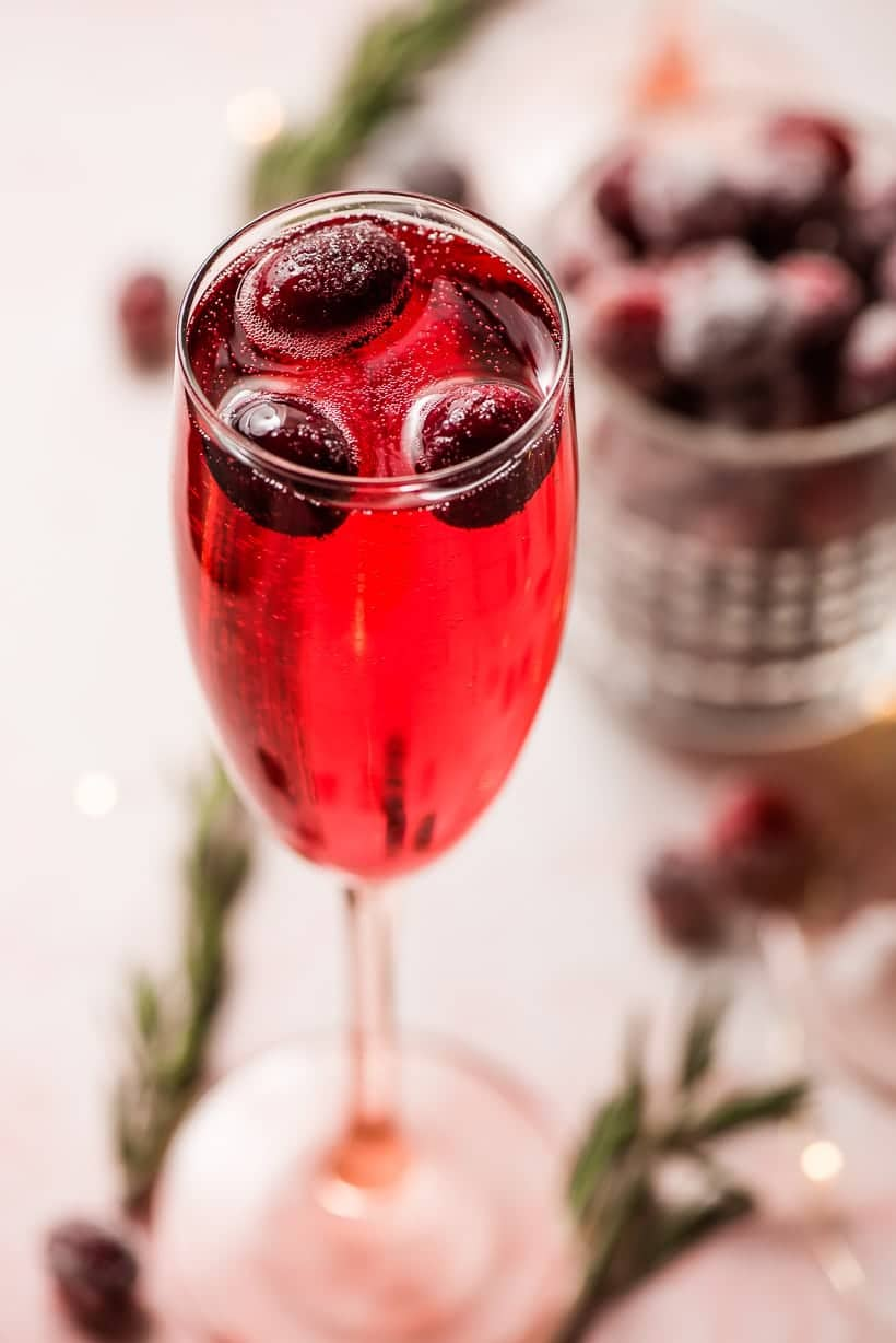 champagne glass filled with cranberry christmas mimosas