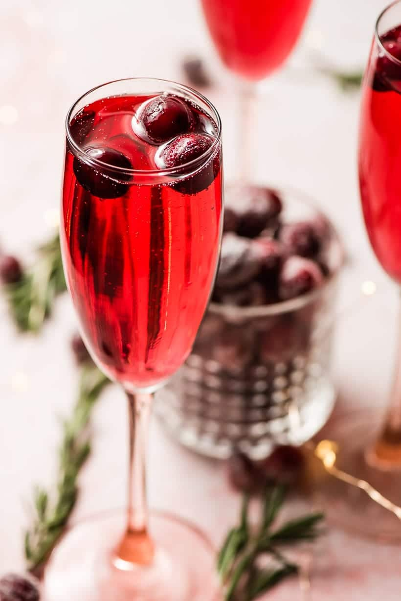 cranberry mimosas with sugared cranberry garnish