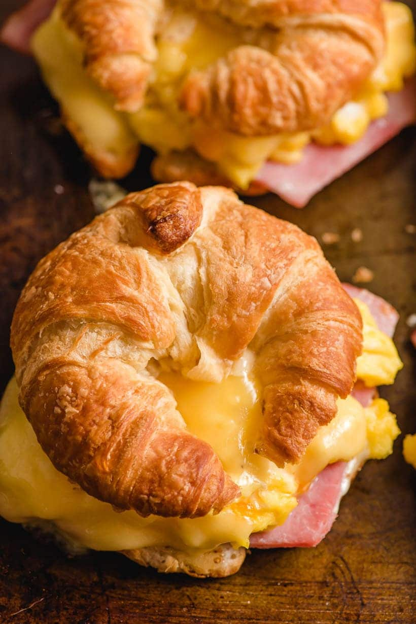 croissant sandwich with eggs, cheese, and ham