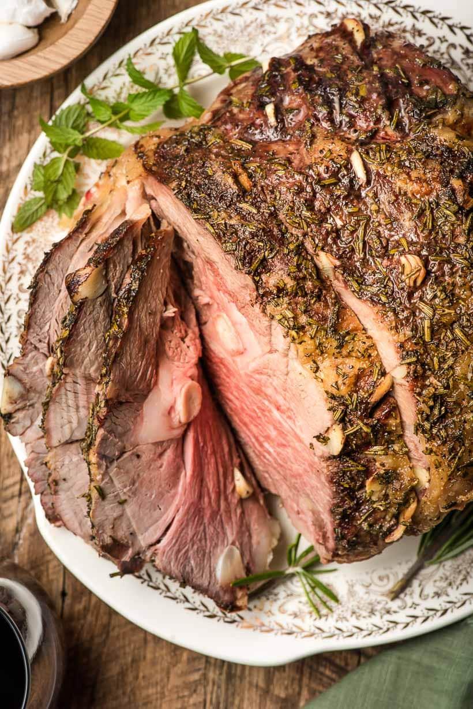 sliced lamb leg roast on plate