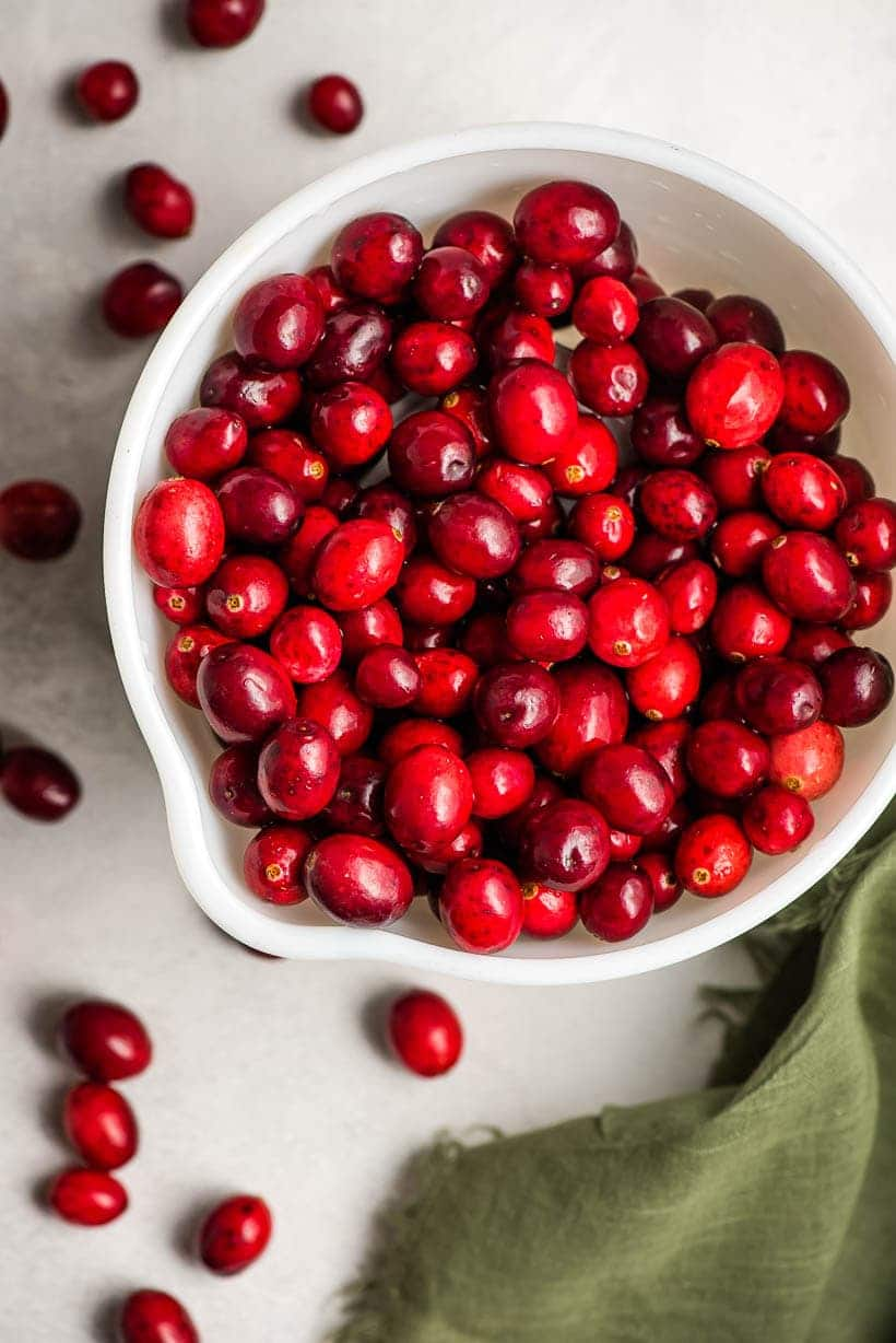 white bowl filled with cranberries