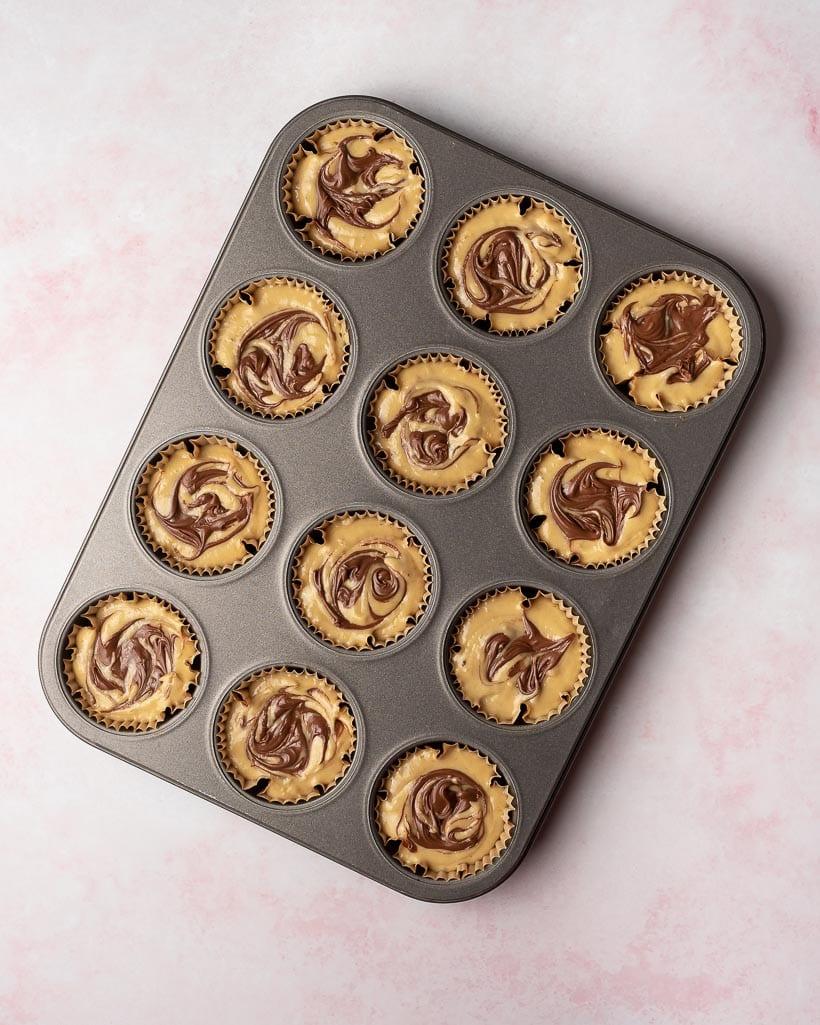 banana muffin batter in a gray tin