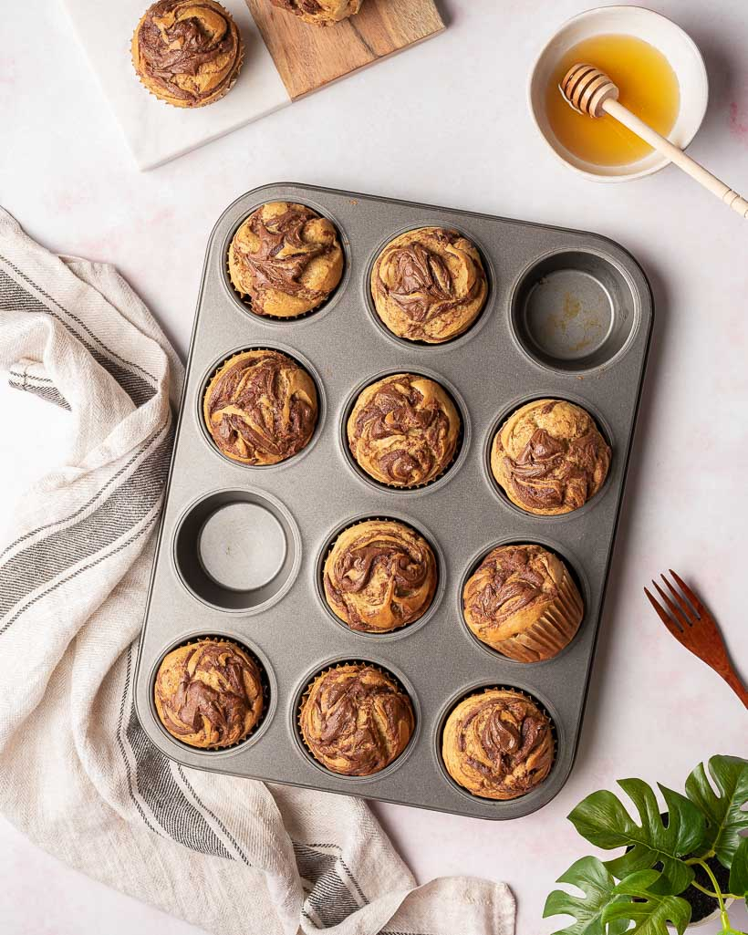 Baked banana nutella muffins in a muffin tin.