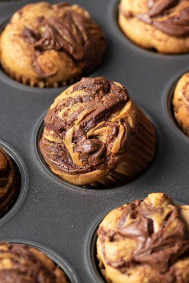 nutella swirled banana muffin in a tin
