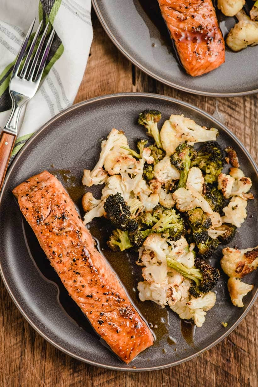 honey soy salmon on a gray plate with roasted vegetables