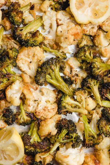 crispy baked cauliflower and broccoli on a baking sheet