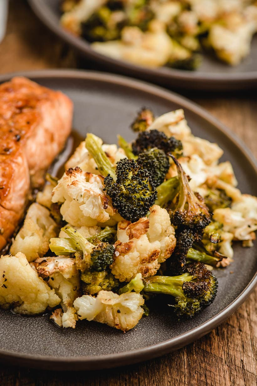 roasted broccoli and cauliflower on a gray plate