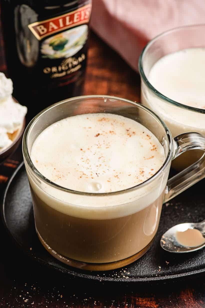 Irish Cream Coffee in a glass mug with whipped cream and nutmeg on top.