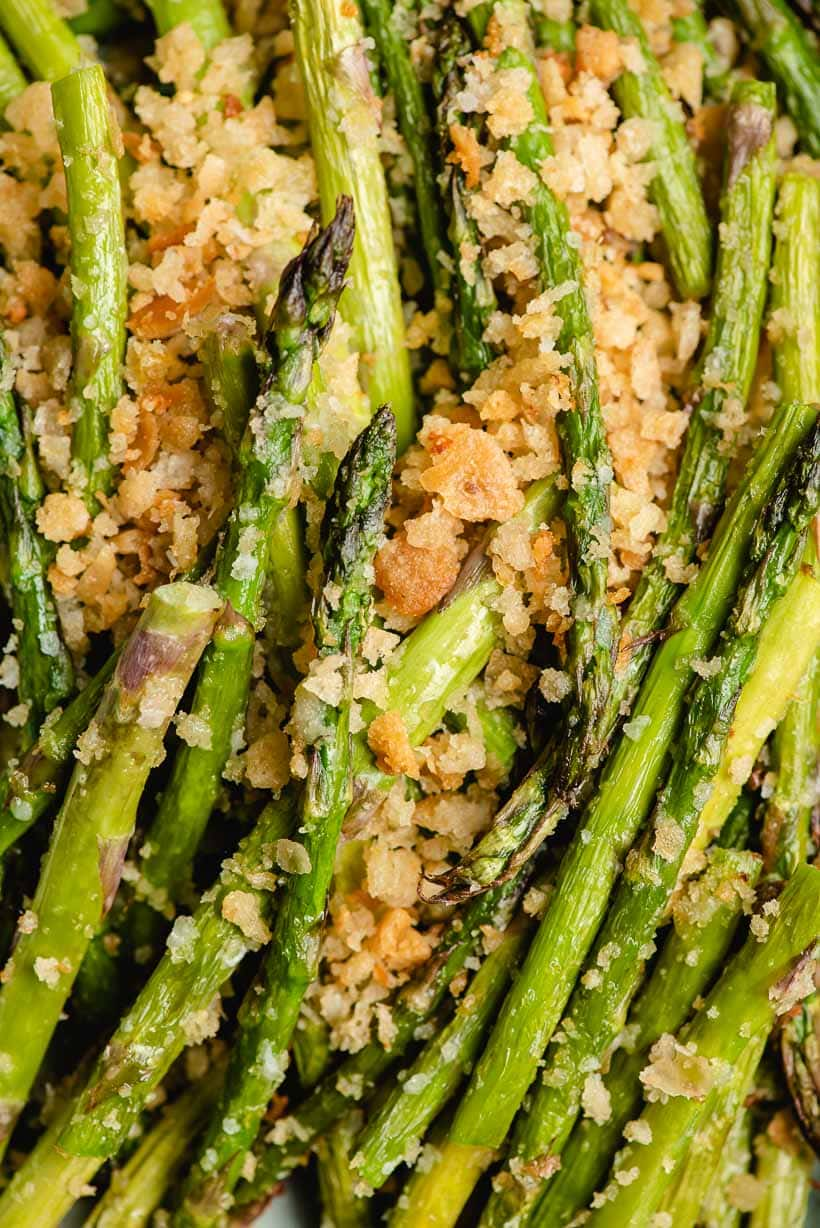 Up close image of fried asparagus with garlic butter breadcrumbs.