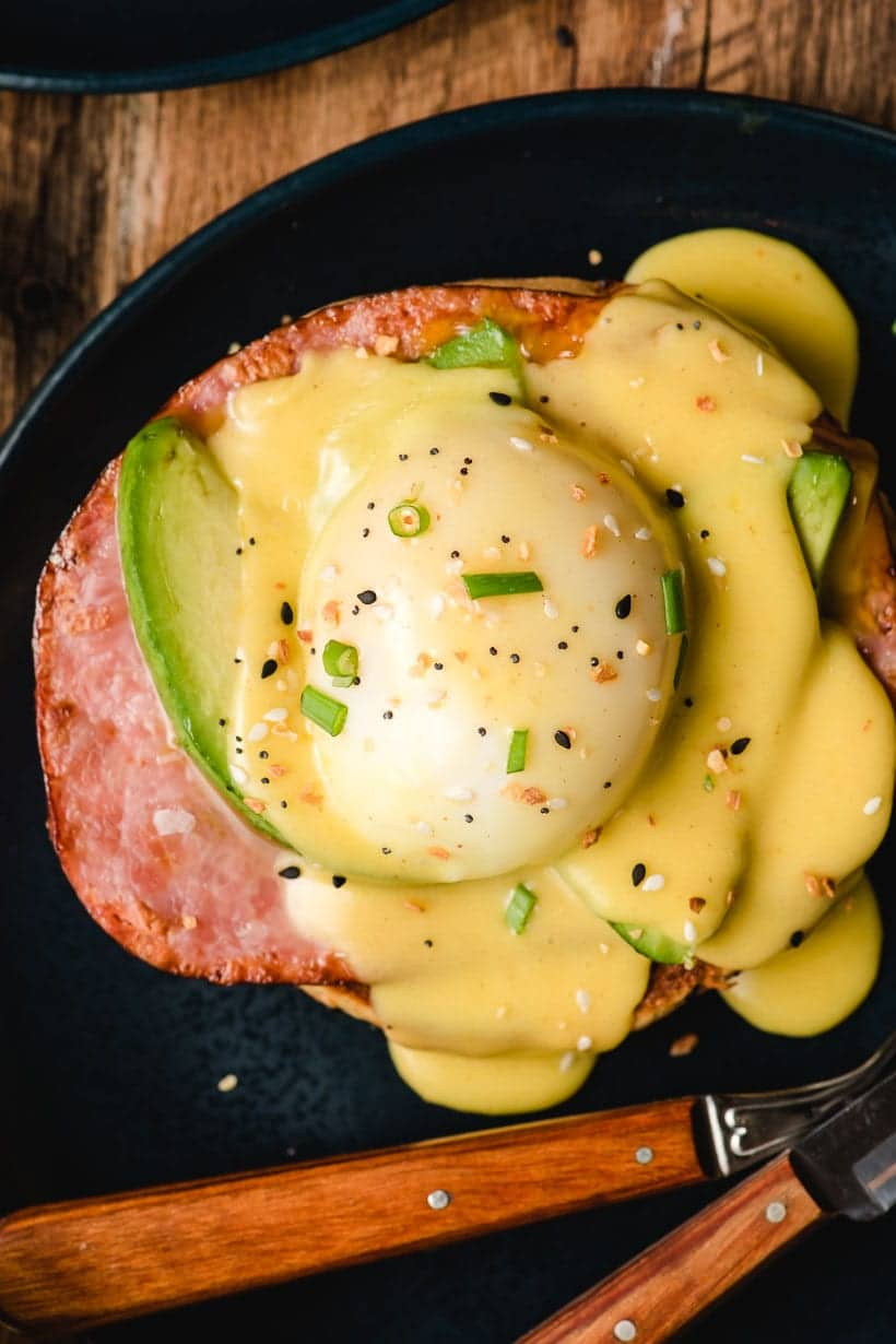 Ham, Avocado, Poached Eggs, and Hollandaise sauce on a bagel