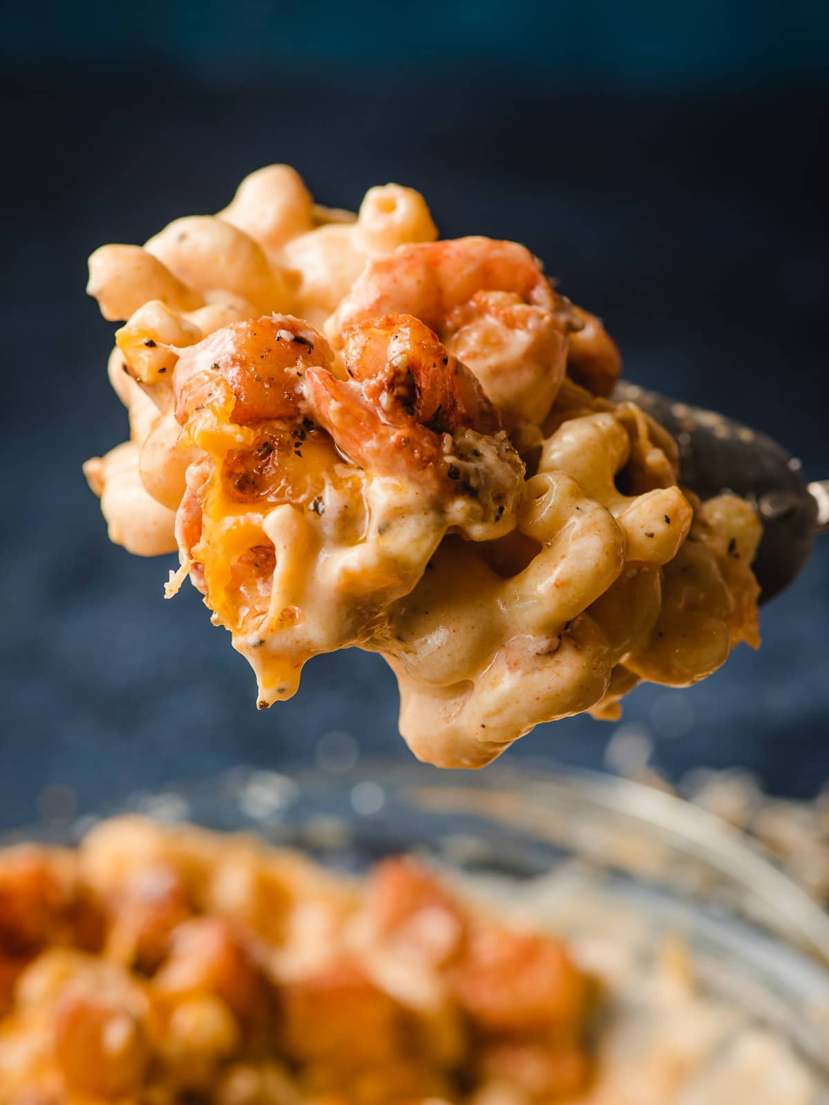 Scoop of Seafood Mac and Cheese.