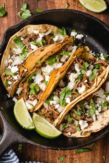 Four corn barbacoa tacos in a small cast iron skillet/